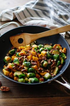 Maple-Cinnamon Glazed Acorn Squash and Brussels Sprouts with Bacon | Dairy free, gluten free, and paleo. | Click for healthy recipe. | Via The Roasted Root