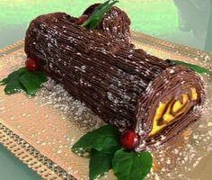 Um sucesso em qualquer mesa de Natal a sugestão aqui apresentada é de um tronco de Natal com base em torta com recheio de chocolate. Ingredientes necessários à confeção desta …