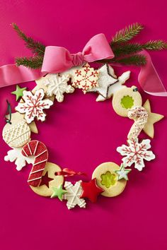 """Twinkling cocoa stars, stained glass """"ornaments"""" and crunchy candy canes are just some of the yummy treats on this eye-candy wreath. Bake extras for eating, of course! Christmas Cupcakes Decoration, Christmas Door Decorations, Christmas Wreaths, Christmas Crafts, Christmas Ideas, Christmas Baking, Christmas Recipes, Christmas Treats To Make, Christmas Tree Cookies"""