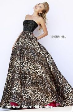 Bring our your wild side in this cheetah print ballgown with a pink lining for a pop of color