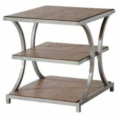 "Curved metal end table with three wood shelves and a silver plata finish.  Product: End tableConstruction Material: Metal and ash veneersColor: Silver plataFeatures: Three shelvesDimensions: 24"" H x 22"" W x 24"" D"