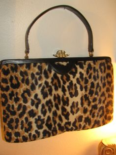 vintage 50s Leopard Purse. Someone tell me why I would have sold all four of my 1950s leopard purses? I do things (like selling and giving away my vintage stuff) and spend forever after pondering why I did it.