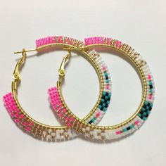 Brick-stitch beaded hoops as pictured above. Another option is a rolled stitch that wraps around the hoop. Buyers choice of style and colors Brick Stitch Earrings, Seed Bead Earrings, Diy Earrings, Hoop Earrings, Beaded Earrings Patterns, Beaded Bracelets, Beadwork Designs, Handmade Jewelry, Diy Jewelry