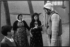 IRAN. Sanandaj. March 1979. A Kurdish woman fondly examines the handgun of a Kurd rebelling against the KHOMEINY regime. ✿♫ღ