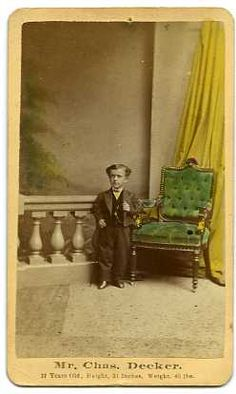 CHARLES DECKER, Sideshow Midget  Decker, born in 1855, grew to an adult only 32 inches high and weighing 45 pounds. He claimed to be the Smallest Man in the World as he traveled sideshows and museums around the US.