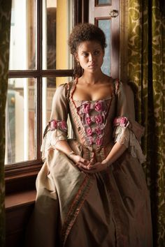 Belle (2013) - Gugu Mbatha-Raw as Dido Elizabeth Belle wearing a period taffeta dress; the sleeves are decorated with lace flounces, while the bodice is embellished with a row of contrasting bows.  The costumes were designed by Anushia Nieradzik.