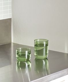 Tint is a collection of glasses made of softly tinted borosilicate glass. They come in sets of two. - H Diameter - Borosilicate glass - Hand wash only Green Kitchen Accessories, Home Accessories, Outdoor Furniture Design, Home Decor Furniture, Glass Tea Cups, Glass Vase, Law Office Design, Lighting Sale, Retro Aesthetic