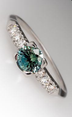 Blue-green sapphire ring - I'm in love with this,  could probably do without the diamonds.