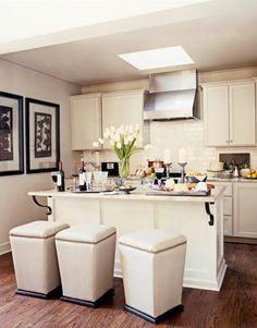 """Space-saving tips for a small kitchen: Match Seating to Wall Color  A trio of backless stools can be slipped under the counter to save space, as in this tight Alabama kitchen, designed by Susan Ferrier. Their cream color blends in with the island, unifying the room. """"You don't want the eye to stutter in a small space,"""" she says. www.housebeautifu..."""