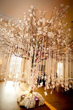 We could do this with big branches and then the papers could be blank and we could leave pens