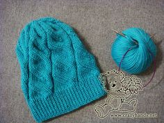 Azure hat with cable knit pattern