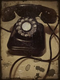 """Grandma had one of these.  Her telephone number was two letters and four numbers.  I think there was a """"party line"""" as well."""