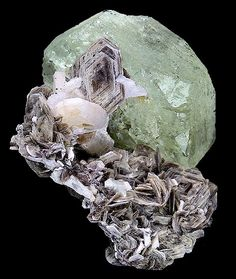 Awesome specimen featuring a large GREEN Beryl with Muscovite and Albite! - From Conselheiro Pena, Doce Valley, Minas Gerais, Southeast Region of Brazil. Minerals And Gemstones, Rocks And Minerals, Color Streaks, Mineral Stone, Rocks And Gems, Gemstone Colors, Gaia, My Favorite Color, Stones And Crystals