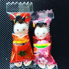 A pair of candies picked up from a convenience store at Kinugawa near Nikko Japan. Look closely you can see the hairpin and even the sandals worn. The head and body are two gumballs with eyes drawn and nicely placed inside each colourful wrapper. Height of Japanese  perfection!