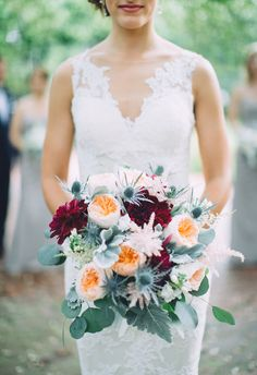 Fluffy peonies, blue thistle for texture, burgundy dahlias for glamour // Paige Schaberg Photography