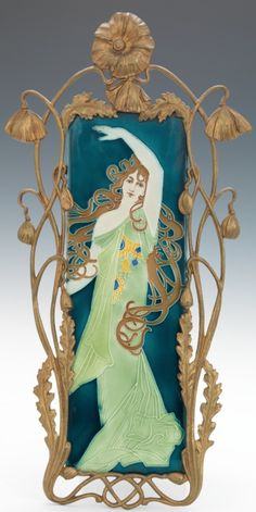Art Nouveau majolica tile of a dancing woman in a gilt metal poppy frame, designed by Carl Luber, manufactured by Johann von Schwarz, Tile: 14-1/4 x 4-5/8 in., ca. 1896-1906. | SOLD $2,472 Aspire Auctions, Sep. 8, 2012 | JV