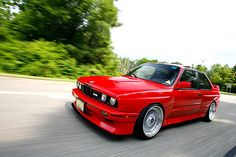 Red BMW e30 M3 on the road