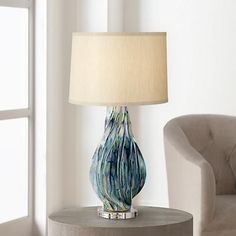 Boasting a clean and sleek appearance, this contemporary table lamp will grace any area with a stylish and attractive flair.