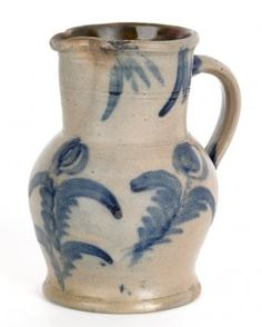 Pennsylvania stoneware pitcher, attributed to Remmey, 19th c., with cobalt tulip decoration