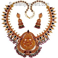 22 Karat Gold Ruby Emerald laxmi Necklace Set. SKU # 8-03205 http://www.malanijewelers.com/Temple-jewellery-Collection.aspx?size=18