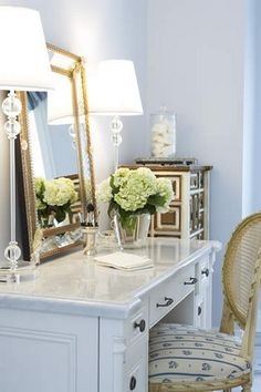 Romantic and love the mirror leaning instead of hanging - love the tall lamps and simple decor (one vase of flowers). Simple, warm and feminine.