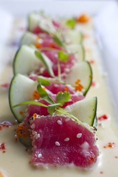 Sashimi Tiradito Nikkei (tuna with creamy lime sauce made with soy sauce, oyster sauce mirin and sesame seed oil and cucumbers) Seafood Recipes, Gourmet Recipes, Cooking Recipes, Gourmet Foods, Gourmet Desserts, Detox Recipes, Sashimi, Think Food, Love Food