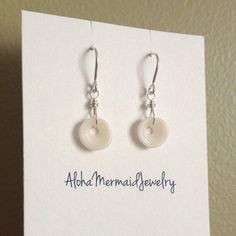 Shop Women's AlohaMermaidJewelry White Silver size OS Earrings at a discounted price at Poshmark. Description: Handmade Hawaiian puka shell sterling silver wire dangle drop earrings. Handmade by me! My shells are all hand-picked from the beaches and oceans here in Hawaii! 🌈🏝🌺 MADE TO ORDER (item may appear slightly different from photo). Sold by mermaidannieb. Fast delivery, full service customer support.