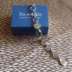 "Lia Sophia HYPNOTIC Toggle Bracelet NEW!!! New in box Lia Sophia toggle bracelet. Silver Matt metal with Blue/Green cut crystals. Measures 8"" long Lia Sophia Jewelry Bracelets"