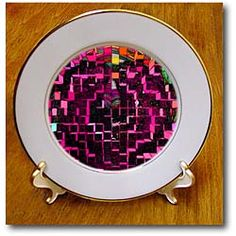 A colorful design with an extrusion in pink, black, green and blue Plate