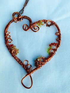 Copper wire wrapped and beaded  heart pendant by ByMyOwnHandsCBC, $22.00