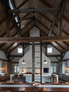 Exposed beams in this old barn - great look for a kitchen tons of space   19th Century Barn, Dutch Stone House: Kate Johns Architectural Firm