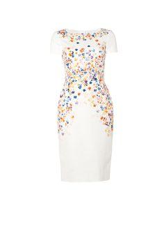 Dr Rania gebloemde kokerjurk van L.K. Bennett. Deze stijlvolle jurk is voorzien van een ronde hals en korte mouwen. Verder is het witte exemplaar verrijkt met een kleurrijk gebloemd dessin. Het aansluitende model is daarbij afgewerkt met een split en een blinde rits aan de achterzijde.