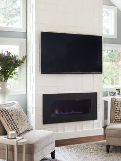 Molding in a fancy gridwork pattern makes this modern space sing: http://www.bhg.com/decorating/fireplace/styles/contemporary-fireplace-ideas/?socsrc=bhgpin101014onthegrid&page=2
