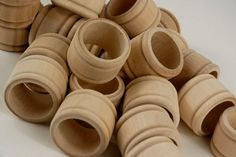 Could be cool to personalize and finish these wood napkin rings with family member names.  25 in a set.