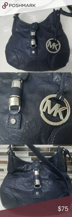 NWOT Authentic Michael Kors Vintage Crossbody Bag Bag is in new condition.   Never used no scratches.  It's navy, but sometimes looks black.  The straps are about 46 inches long.  Michael Kors Bags Crossbody Bags