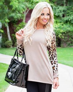 Make a statement with some animal print! Our leopard sleeve tops will be a