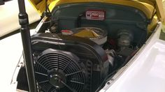 engine in yellow coupe