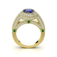 The Vanessa Ring in blue sapphire, diamond, emerald, and yellow gold