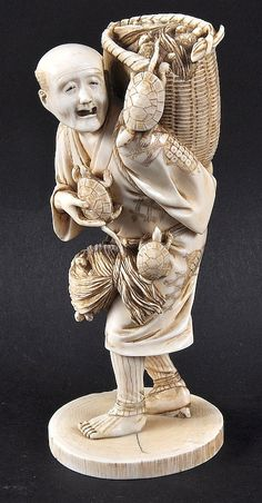 A LATE 19TH CENTURY JAPANESE MEIJI PERIOD IVORY OKIMONO depicting a standing male with tortoises. Signed. 6.25ins high.