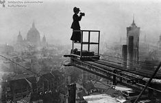 ca 1910 a female photographer surveys Berlin from a crane being used in the construction of the Stadthaus am Molkenmarkt