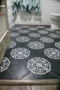 Super affordable bathroom floor makeover solution: how to chalk paint tile floors! So glad I painted my bathroom floors, they look amazing and we spent less than $50! Love this bathroom floor makeover!