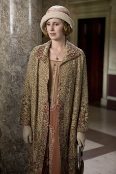 "Edith's coat is very 20's (possibly vintage fabric or actual vintage clothing) w/ very little tailoring but ""wild"" w/ insets & contrasting prints (possible over-embroidered details or insets)"