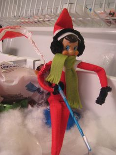 Elf on the Shelf is Ice Fishing..He is all dressed for the cold, has earmuffs on..Flickr - Photo Sharing!