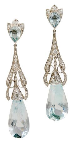 Art Deco diamond and aquamarine ear pendants. Each ear pendant set with diamonds, suspending a large pear-shaped aquamarine drop, mounted in platinum. USA,1920s.