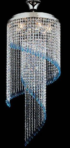 The Kolarz Art Deco Spiral Crystal Chandelier is available from Luxury Lighting. The Art Deco Cascade by Kolarz Lighting is silver plated and is dressed with Swarovski crystal drops.