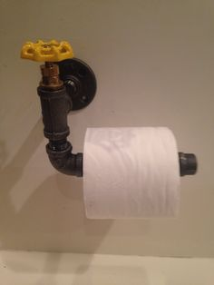 Industrial black pipe toilet paper holder with yellow Faucet