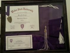 Take cap and gown, tassle, degree, and honor cord and place in a shadow box frame! Looks so aweome on the den wall instead of in a box.