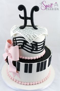 We loved creating this musical themed birthday cake for a music lover turning 50! The sheet music was custom made for the guest of honor - asweetpassion.com