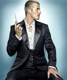 David Beckham reveals his impeccable pecs in new ad campaign