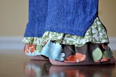 What a great (and cute!) idea...just sew a ruffle inside the pant leg to lengthen the pants your girls have outgrown.
